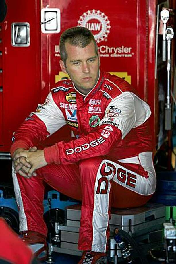 FILE - In this May 26, 2005, file photo, Jeremy Mayfield sits in the garage during practice at Lowe's Motor Speedway in Concord, N.C. The general manager of Mayfield's race team says he has left the organization because he doesn't believe Mayfield Motorsports will return to the race track. Bobby Wooten says he was the last remaining employee. (AP Photo/Gerry Broome, File) Photo: Gerry Broome, AP