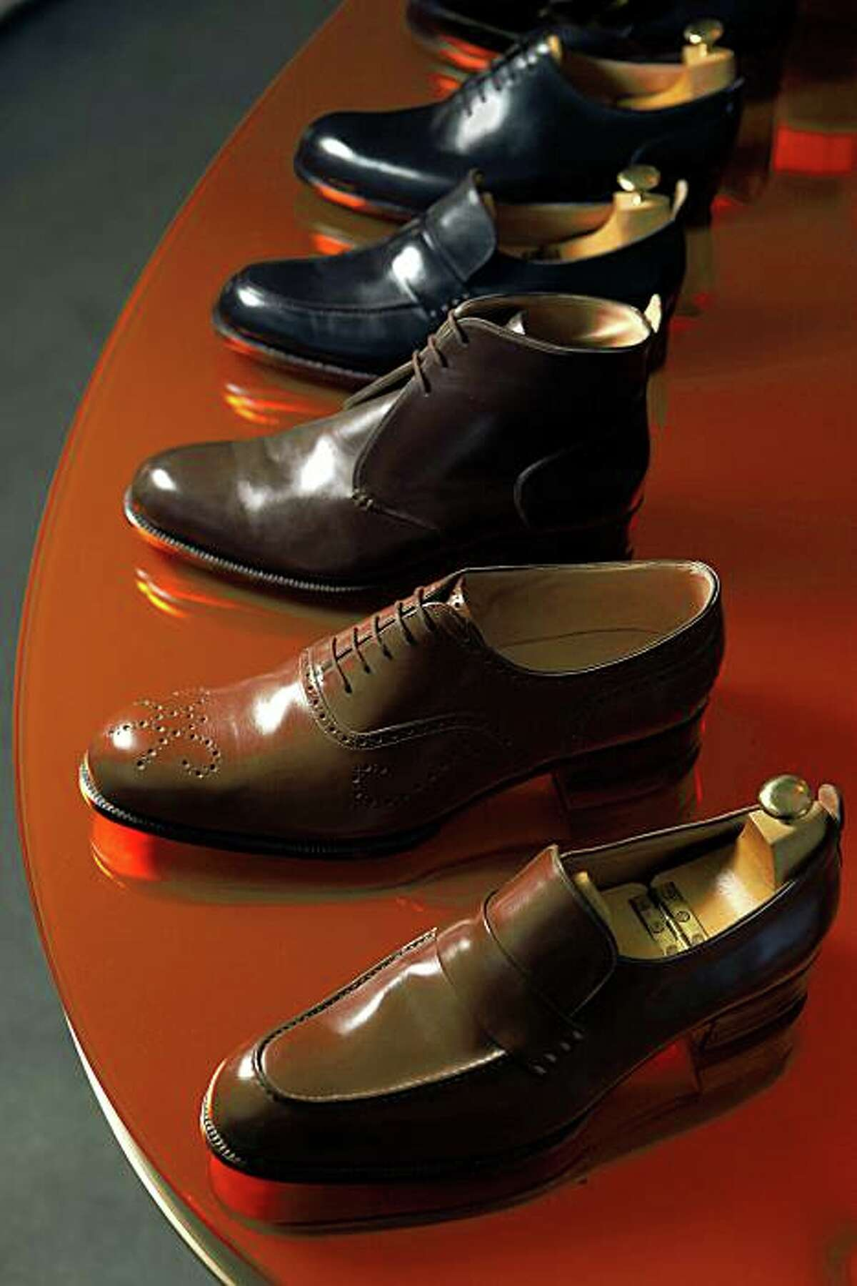 (from bottom) A brown loafer, an extreme brogue, a saddle shoe, a conker loafer and a wholecut. James Ducker of