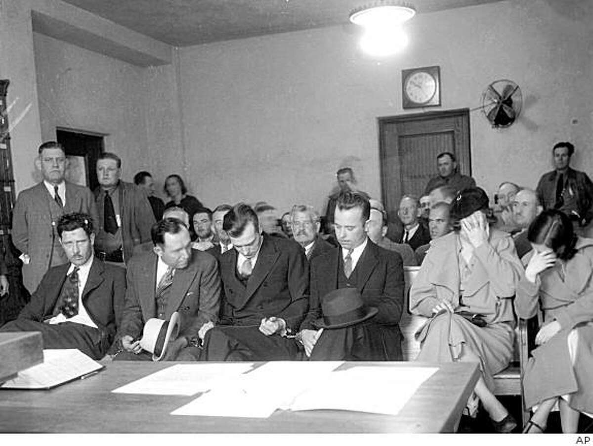 FILE - In this Jan. 25, 1934 file photo, members of the Dillinger outlaw gang, from left, Russel Clark, Charles Makley, Harry Pierpont, John Dilliger, Ann Martin and Mary Kinder are arraigned in Tucson, Ariz. (AP Photo, file)