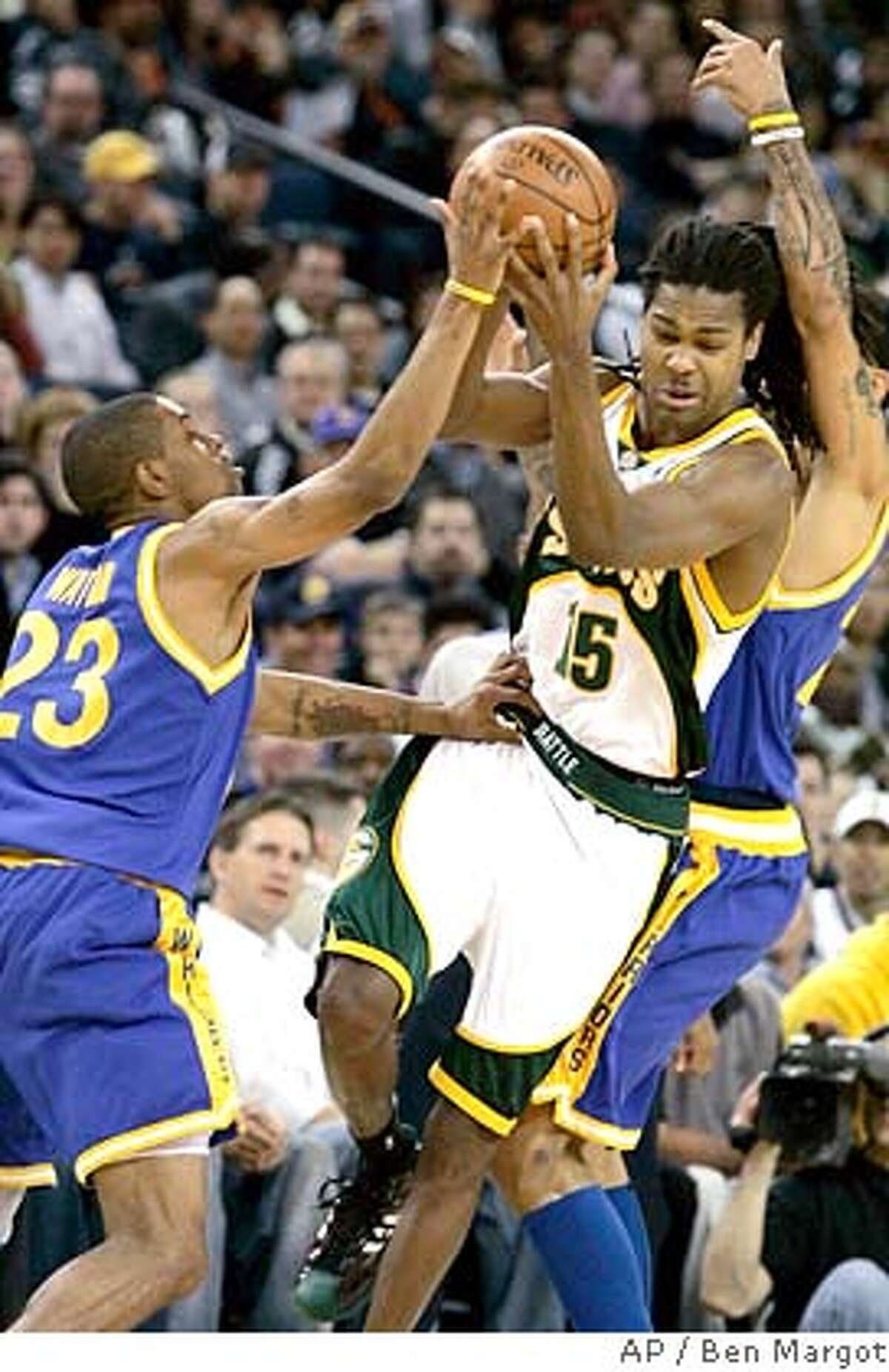 Golden State Warriors' C.J. Watson (23) guards against Seattle SuperSonics' Mickael Gelabale (15), of France, during the first half of an NBA basketball game Tuesday, Feb. 26, 2008, in Oakland, Calif. (AP Photo/Ben Margot)
