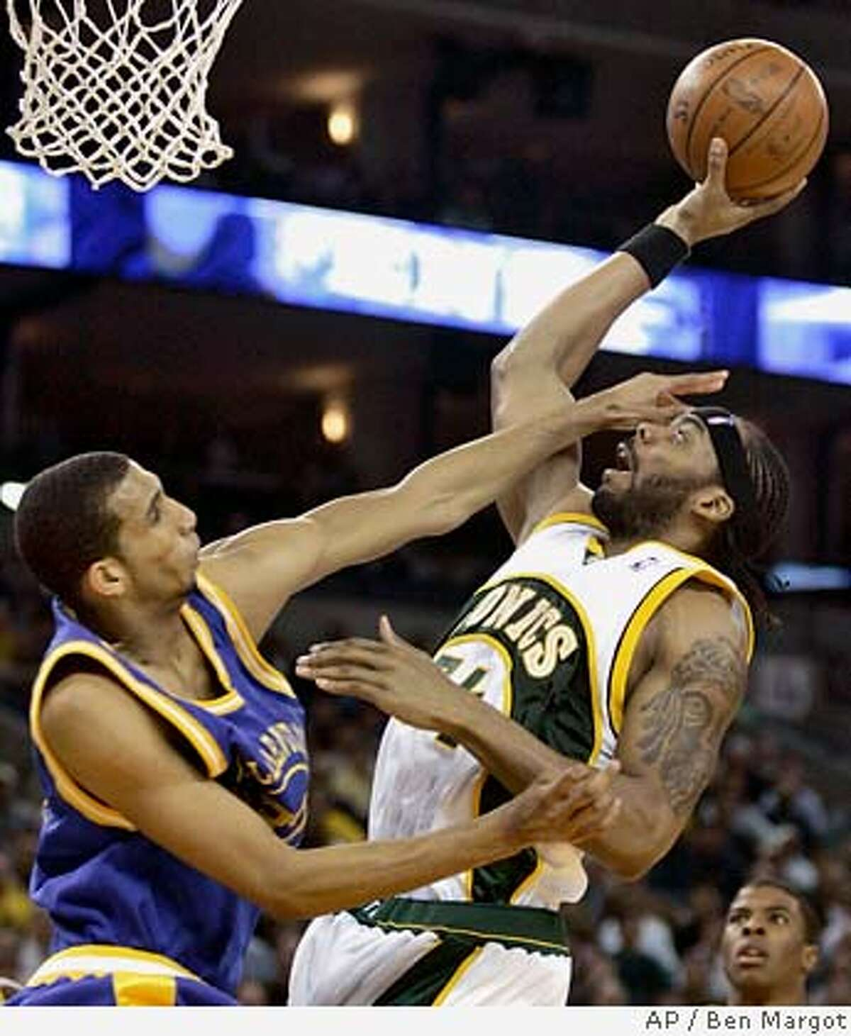 Golden State Warriors' Brandan Wright, left, defends against Seattle Supersonics' Chris Wilcox during the first half of an NBA basketball game Tuesday, Feb. 26, 2008, in Oakland, Calif. (AP Photo/Ben Margot)