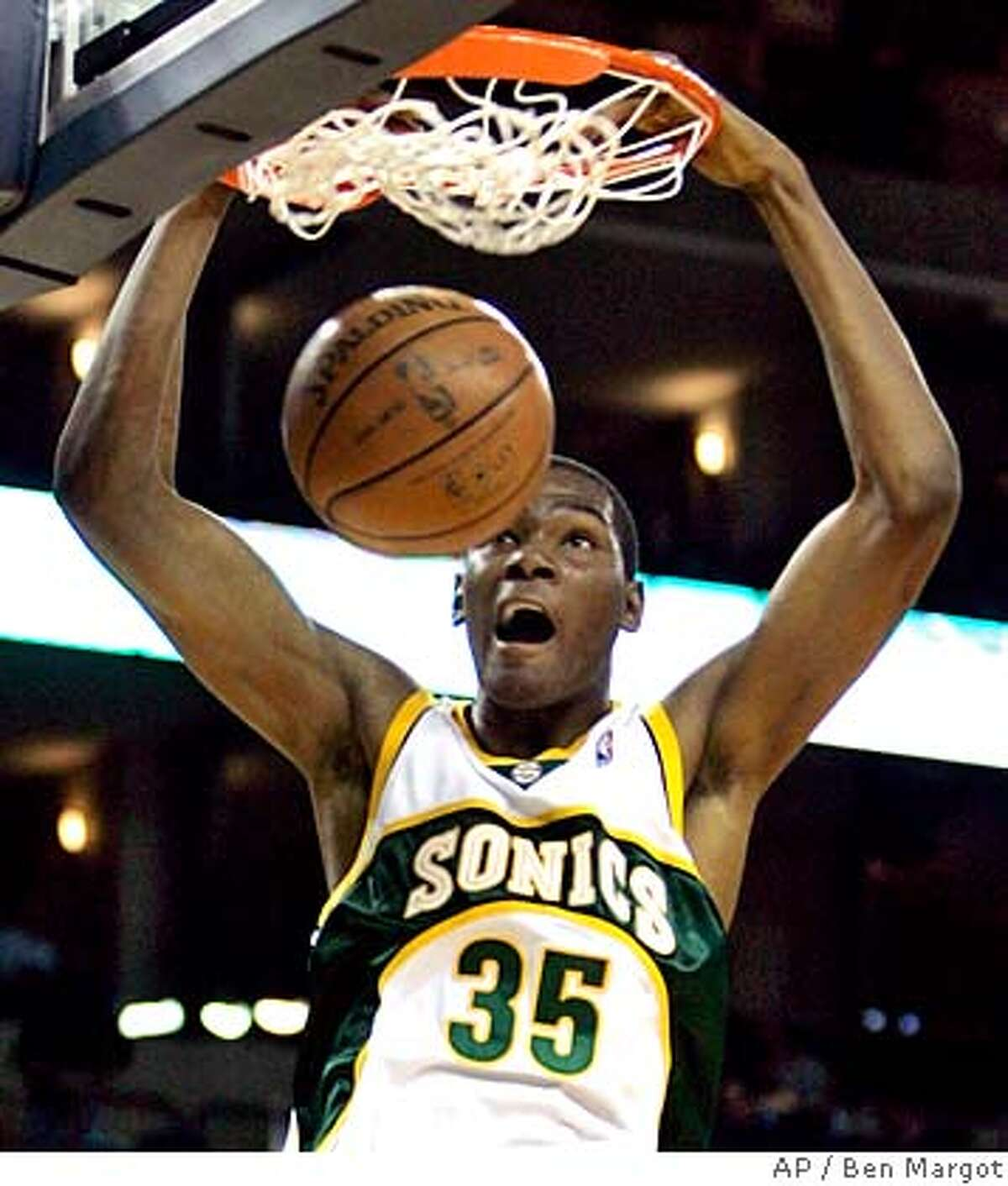 Seattle Supersonics' Kevin Durant dunks against the Golden State Warriors during the first half of an NBA basketball game Tuesday, Feb. 26, 2008, in Oakland, Calif. (AP Photo/Ben Margot)