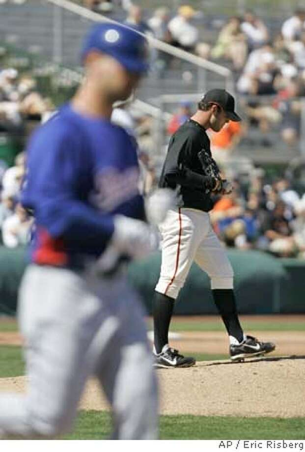 ###Live Caption:San Francisco Giants starting pitcher Noah Lowry, right, walks back to the mound after walking the Texas Rangers' Ryan Roberts, left, during the first inning of their spring training baseball game in Scottsdale, Ariz., Monday, March 3, 2008. Lowry walked seven batters allowing four runs to score in the first inning. (AP Photo/Eric Risberg)###Caption History:San Francisco Giants starting pitcher Noah Lowry, right, walks back to the mound after walking the Texas Rangers' Ryan Roberts, left, during the first inning of their spring training baseball game in Scottsdale, Ariz., Monday, March 3, 2008. Lowry walked seven batters allowing four runs to score in the first inning. (AP Photo/Eric Risberg)###Notes:Noah Lowry, Ryan Roberts###Special Instructions:EFE OUT Photo: Eric Risberg