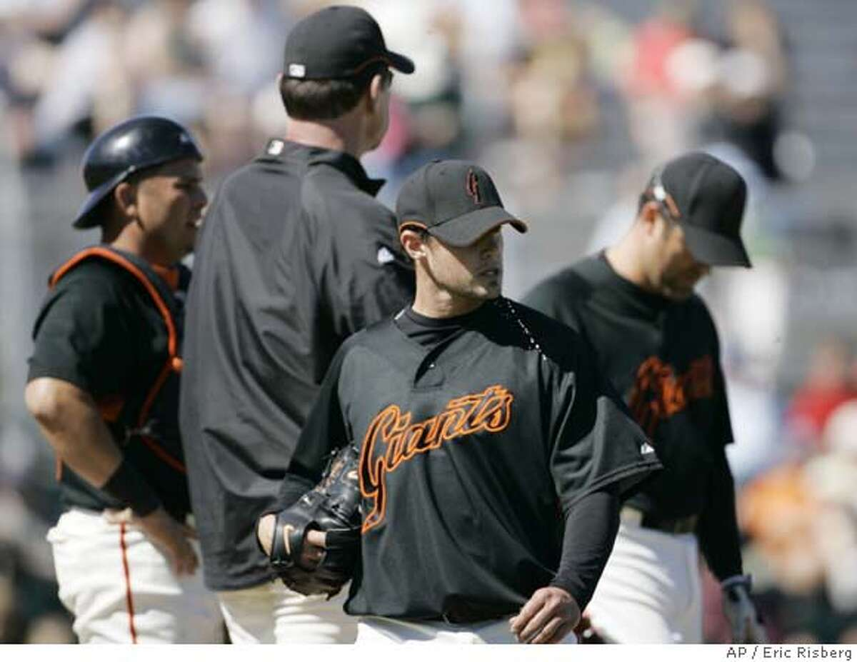 ###Live Caption:San Francisco Giants starting pitcher Noah Lowry walks to the dugout after being removed in the second inning of their spring training baseball game against the Texas Rangers, in Scottsdale, Ariz., Monday, March 3, 2008. In the background from left are Giants catcher Eliezer Alfonzo, manager Bruce Bochy and third baseman Rich Aurilia. (AP Photo/Eric Risberg)###Caption History:San Francisco Giants starting pitcher Noah Lowry walks to the dugout after being removed in the second inning of their spring training baseball game against the Texas Rangers, in Scottsdale, Ariz., Monday, March 3, 2008. In the background from left are Giants catcher Eliezer Alfonzo, manager Bruce Bochy and third baseman Rich Aurilia. (AP Photo/Eric Risberg)###Notes:Noah Lowry, Eliezer Alfonzo, Bruce Bochy, Rich Aurilia###Special Instructions:EFE OUT