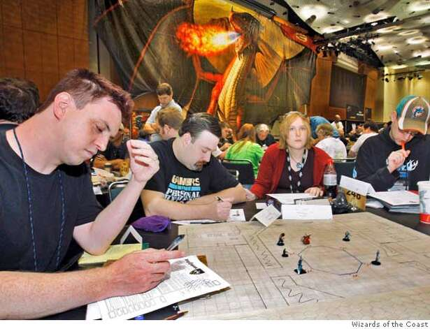 (NYT62) INDIANAPOLIS -- March 4, 2008 -- OBIT-GYGAX -- Participants playing Dungeons & Dragons at a game convention in Indianapolis in August 2007. Gary Gygax, a pioneer of the imagination who transported a fantasy realm of wizards, goblins and elves onto millions of kitchen tables around the world through the game he helped create, Dungeons & Dragons, died Tuesday, March 4, 2008 at his home in Lake Geneva, Wis. He was 69. His death was confirmed by his wife, Gail Gygax, who said he had been ailing and had recently suffered an abdominal aneurysm, The Associated Press reported. (Wizards of the Coast via The New York Times)*EDITORIAL USE ONLY*  Ran on: 03-06-2008  Dungeons & Dragons players at an Indianapolis game convention. Co-creator Gary Gygax's fantasy world godfathered the role-playing games of today. Gygax died Tuesday at age 69. Photo: WIZARDS OF THE COAST