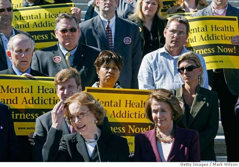 ###Live Caption:WASHINGTON - MARCH 05: Former first lady Rosalynn Carter (L) speaks during a rally while House Speaker Nancy Pelosi (D-CA) (R) stands nearby at the U.S. Capitol, March 5, 2008 in Washington DC. The rally was held to give support to bi-partisan mental health legislation that is before Congress. (Photo by Mark Wilson/Getty Images)###Caption History:WASHINGTON - MARCH 05: Former first lady Rosalynn Carter (L) speaks during a rally while House Speaker Nancy Pelosi (D-CA) (R) stands nearby at the U.S. Capitol, March 5, 2008 in Washington DC. The rally was held to give support to bi-partisan mental health legislation that is before Congress. (Photo by Mark Wilson/Getty Images)###Notes:Rosalyn Carter Joins House Democrats At Mental Health Rally###Special Instructions: Photo: Mark Wilson