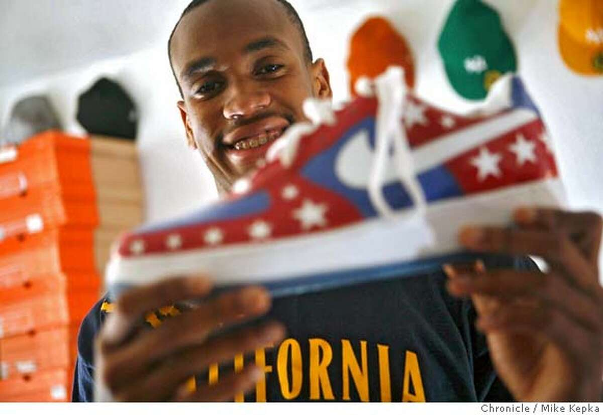 In his apartment, Patrick Christopher, basketball player for U.C. Berkeley, shows off a pair of