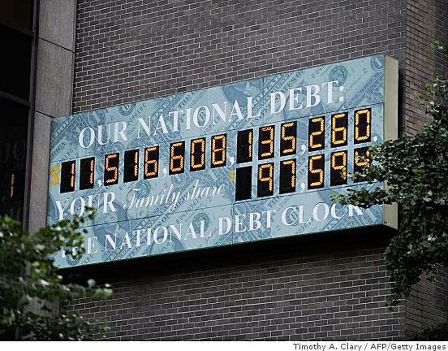 The National Debt Clock in midtown New York July 13, 2009 shows that the federal deficit has topped $1 trillion for the first time ever and could grow to nearly $2 trillion by this fall.  AFP PHOTO / TIMOTHY A. CLARY (Photo credit should read TIMOTHY A. CLARY/AFP/Getty Images) Photo: Timothy A. Clary, AFP/Getty Images