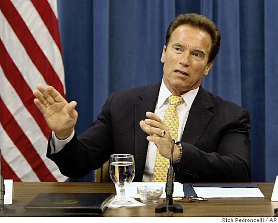Gov. Arnold Schwarzenegger responds to a question concerning the budget negotiations while talking with reporters at the Capitol in Sacramento, Calif., Wednesday, July 15, 2009.  Schwarzenegger said that he and top lawmakers are close to solving California's $26.3 billion budget shortfall but cautioned that difficult decisions remain. (AP Photo/Rich Pedroncelli) Photo: Rich Pedroncelli, AP