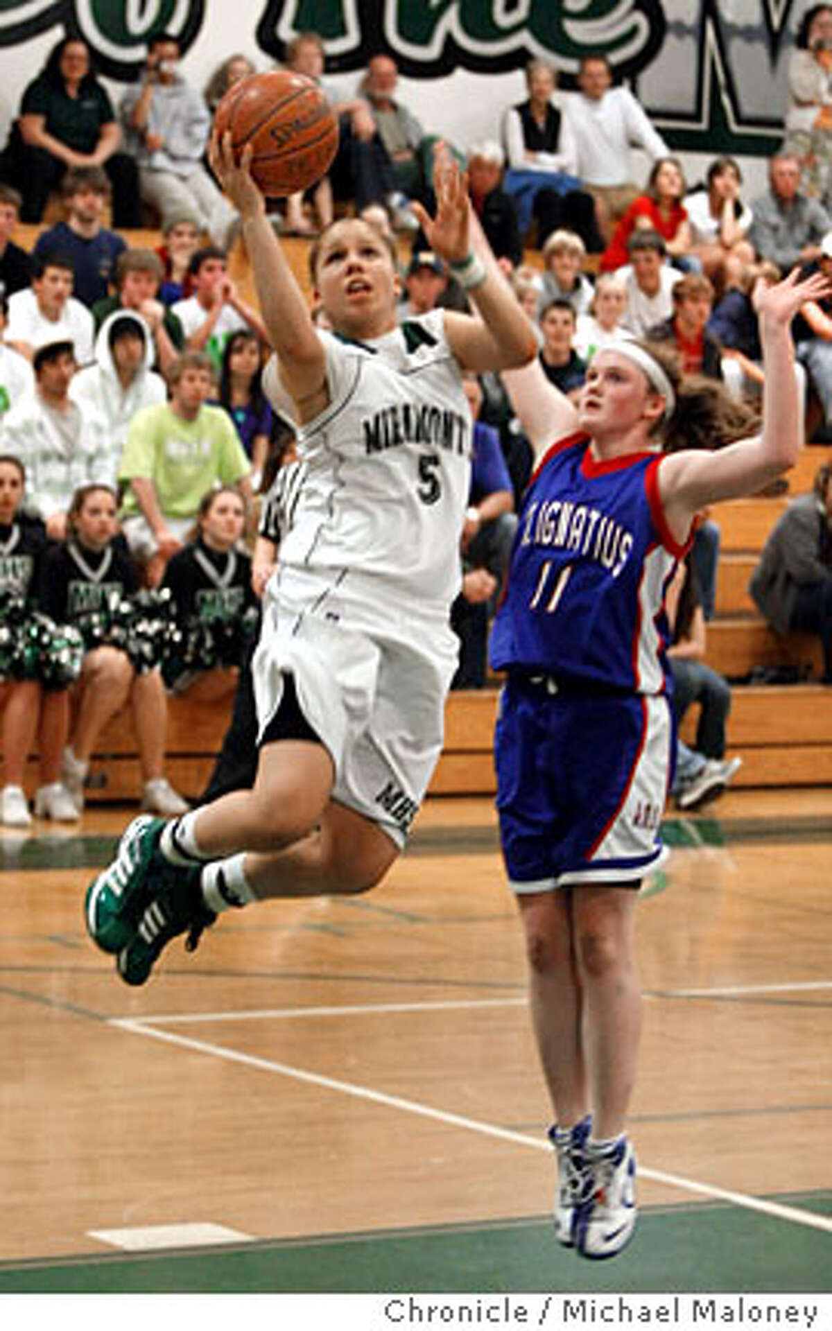 Miramonte's Katie Evans (5) goes up for a basket in the 4th period. St. Ignatius' Rachel Hatch (11) defending. Miramonte high school in Orinda, Calif. hosts San Francisco's St. Ignatius high school in a 1st-round NorCal girl's playoff basketball game Tuesday night, March 4, 2008. Miramonte won 70-54. Photo by Michael Maloney / San Francisco Chronicle Ran on: 03-05-2008 St. Ignatius Caroline Barrack (front) and Miramontes Katie Batlin vie for a loose ball. Ran on: 03-05-2008 St. Ignatius Caroline Barrack (front) and Miramontes Katie Batlin vie for a loose ball.