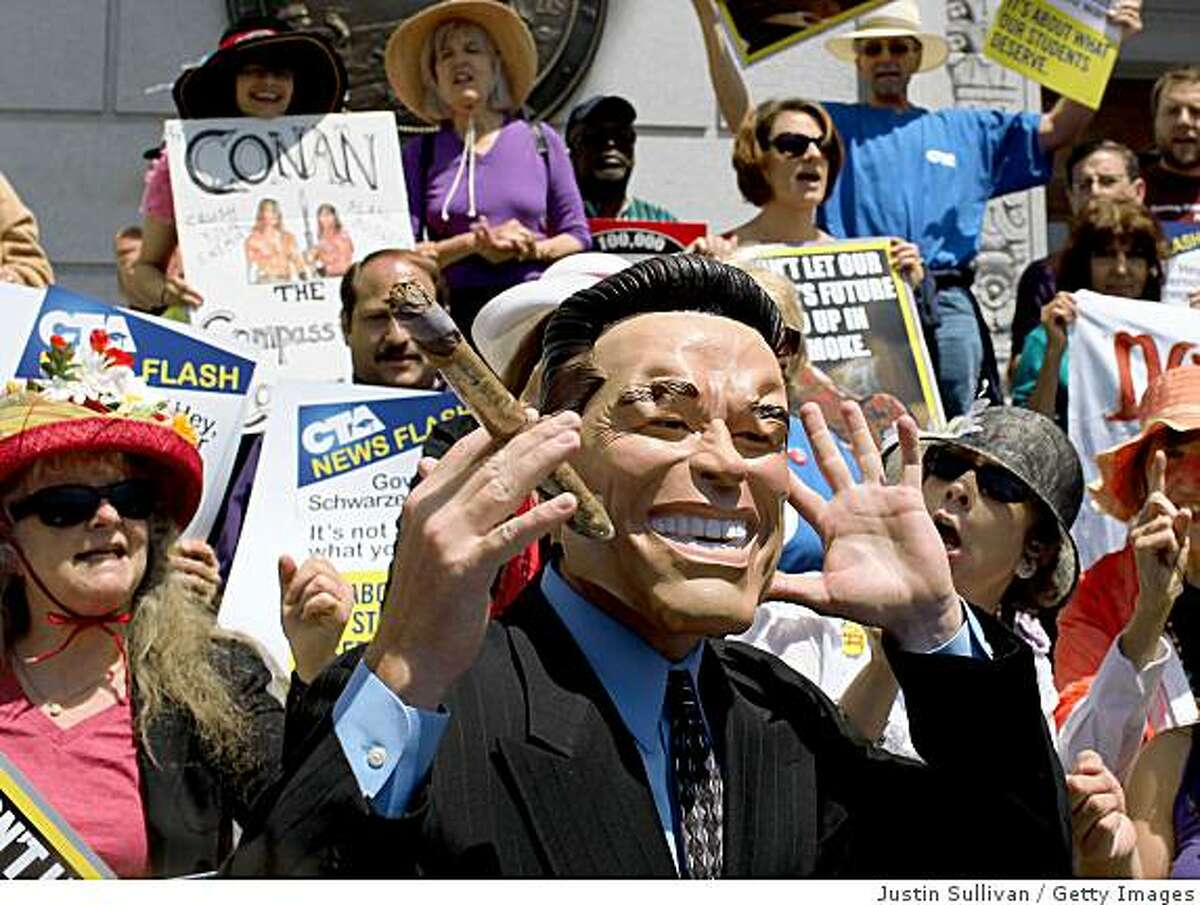 SAN FRANCISCO - JULY 15: A protestor dressed as California governor Arnold Schwarzengger is heckled by the crowd during a demonstration outside of the California State building July 15, 2009 in San Francisco, California. As the California budget crisis continues, dozens of protestors against proposed cuts to education and helthcare demonstrated outside of California governor Arnold Schwarzenegger's San Francisco office. (Photo by Justin Sullivan/Getty Images)