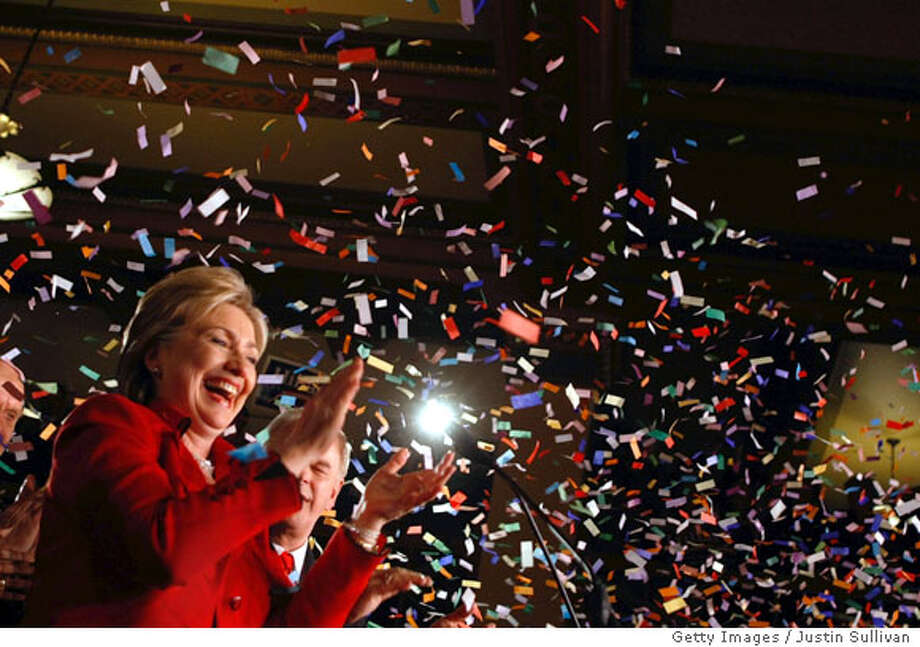 COLUMBUS, OH - MARCH 4: Democratic presidential hopeful Sen. Hillary Clinton (D-NY) claps as confetti flies before she speaks during a primary election night party at The Columbus Athenaeum March 4, 2008 in Columbus, Ohio. Sen. Barack Obama (D-IL) and Clinton are facing off in the crucial Texas primary. Clinton is the projected winner of the important Ohio primary and also in the Rhode Island primary. (Photo by Justin Sullivan/Getty Images) Photo: Justin Sullivan