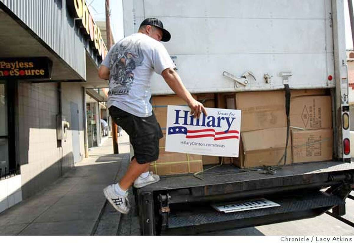 ###Live Caption:Jorge Garcia, 22 years, gets off of the back of his delievery truck after driving through the border waving a sign for Hillary Clinton, Sunday March 2, 2008 in Laredo, Texas. Garcia a US citizen, lives in Nuevo Laredo, Mexico and delievers shoes and other products made in Mexico to the stores in Laredo. Photo by Lacy Atkins / San Francisco Chronicle###Caption History:Jorge Garcia, 22 years, gets off of the back of his delievery truck after driving through the border waving a sign for Hillary Clinton, Sunday March 2, 2008 in Laredo, Texas. Garcia a US citizen, lives in Nuevo Laredo, Mexico and delievers shoes and other products made in Mexico to the stores in Laredo. Photo by Lacy Atkins / San Francisco Chronicle###Notes:Jorge Garcia###Special Instructions:MANDATORY CREDIT FOR PHOTOG AND SAN FRANCISCO CHRONICLE/NO SALES MAGS OUT
