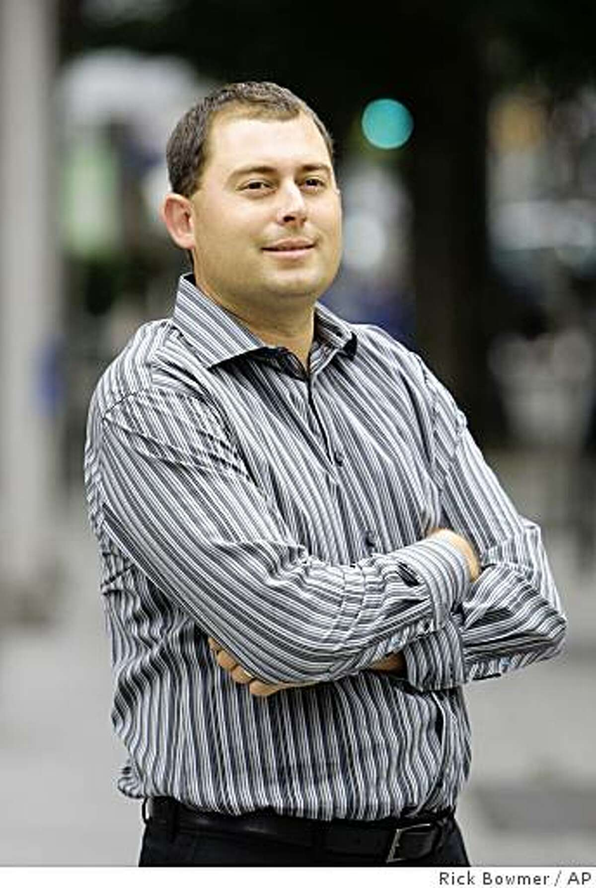 In this photograph taken on Thursday, July 9, 2009, Dusty Schmidt looks on as he stands in downtown Portland, Ore. Schmidt says all he wants to do is be able to compete as an amateur golfer. The USGA maintains that the online poker player gave up his amateur status when he issued a $1 million challenge to anyone who could beat him at 72 holes of golf and a few hands of poker. Now it's up to a judge to decide.(AP Photo/Rick Bowmer)