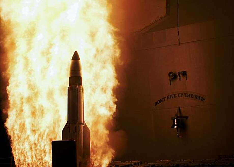 In this image provided by the US Navy a single modified tactical Standard Missile-3 (SM-3) launches from the U.S. Navy AEGIS cruiser USS Lake Erie Wednesday Feb. 20, 2008, successfully impacting a non-functioning National Reconnaissance Office satellite approximately 247 kilometers (133 nautical miles) over the Pacific Ocean, as it traveled in space at more than 17,000 mph. President George W. Bush decided to bring down the satellite because of the likelihood that the satellite could release hydrazine fuel upon impact, possibly in populated areas. (AP Photo/US Navy) Photo: Navy, AP
