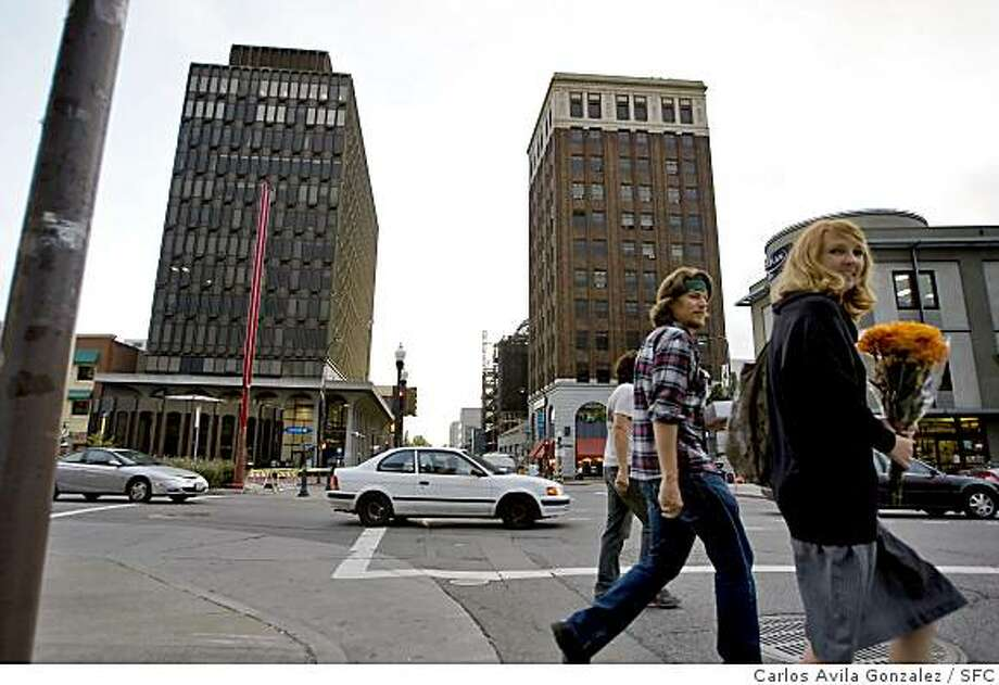 "The Berkeley City Council is poised to dramatically increase the density of its downtown, raising heights throughout the area but also specifying nine towers, including three of up to 225 feet. Two buildings at Center St. and Shattuck Ave, the Wells Fargo Bldg and the former ""powerbar"" building, are the tallest in the city now, and are at around 180 feet. City planners say nothing like them has been built in Berkeley since at least the 1970s. Photo: Carlos Avila Gonzalez, SFC"