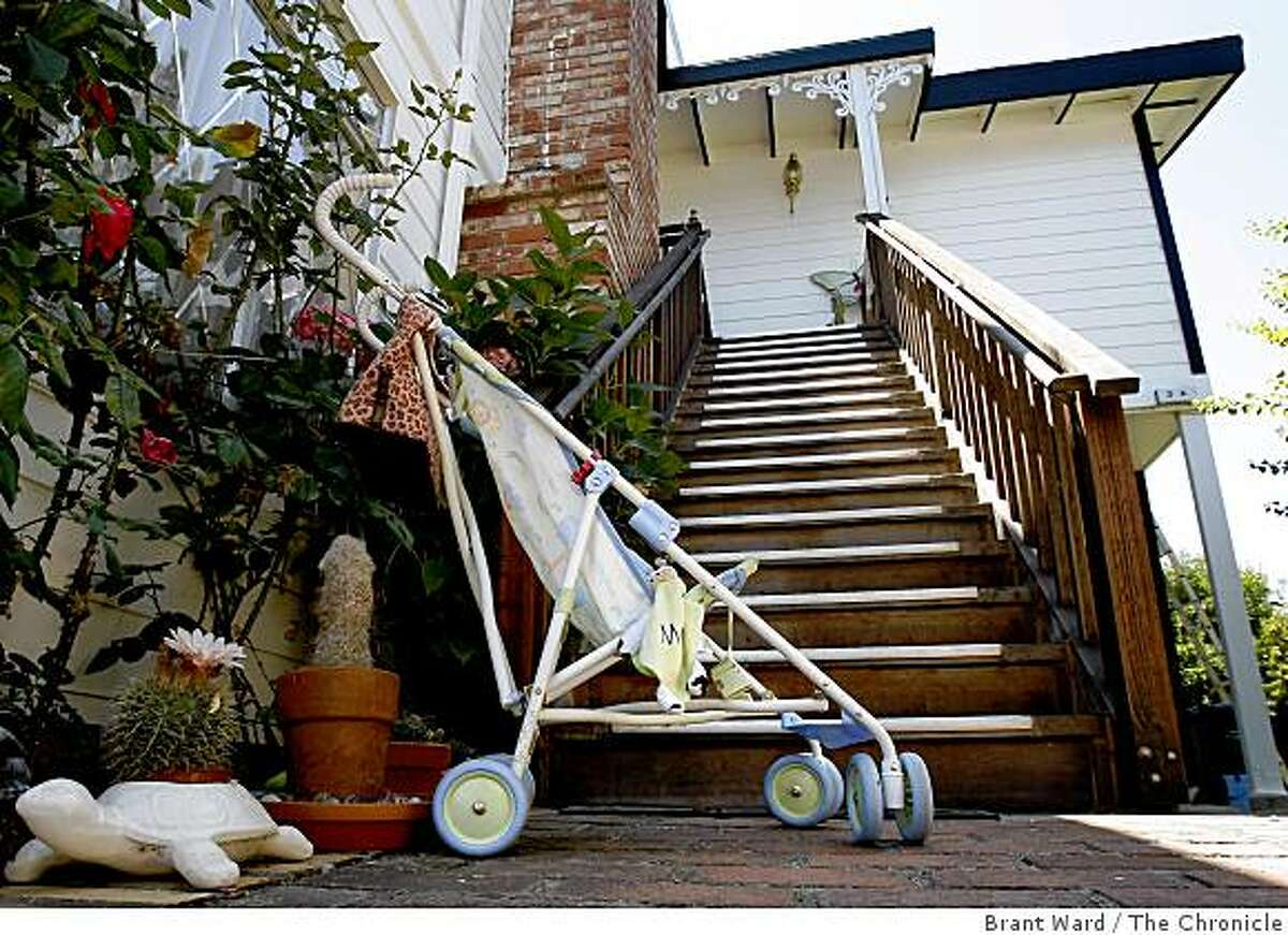 A child's s stroller sat at the bottom of the stairs that leads to the victim's home in Novato. The son of former porn king Jim Mitchell was arrested for murder of Danielle Keller and the kidnapping of his one year old daughter.