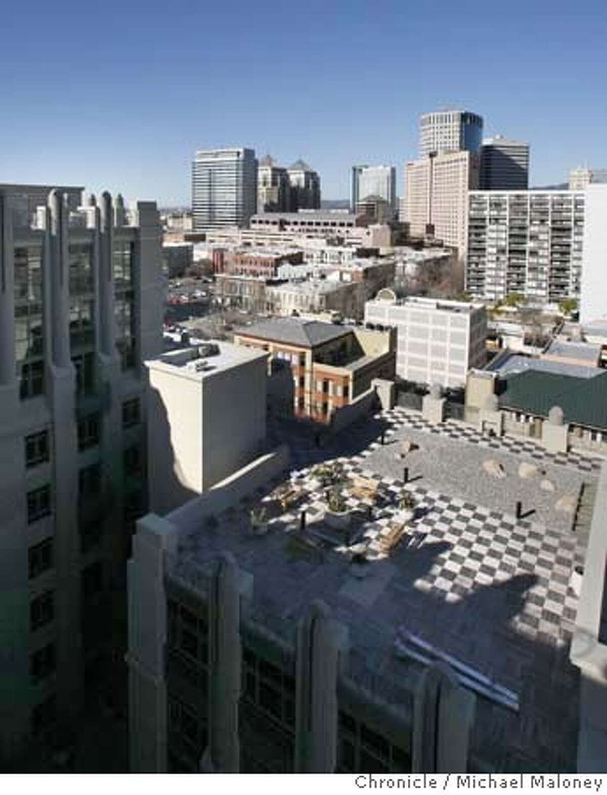 ###Live Caption:Downtown Oakland can be seen from the roof top common patio (lower right) of the new Eight Orchids European-style luxury condominiums, photographed on March 5, 2008. The developer of the recently opened Eight Orchids condominium complex in Oakland, Calif., hopes to sell off nearly a third of the units through a one-day auction on March 30, 2008. Observers say the tactic suggests builders are struggling to unload properties in the current financial climate. Photo by Michael Maloney / San Francisco Chronicle###Caption History:Downtown Oakland can be seen from the roof top common patio (lower right) of the new Eight Orchids European-style luxury condominiums, photographed on March 5, 2008. The developer of the recently opened Eight Orchids condominium complex in Oakland, Calif., hopes to sell off nearly a third of the units through a one-day auction on March 30, 2008. Observers say the tactic suggests builders are struggling to unload properties in the current financial climate. Photo by Michael Maloney / San Francisco Chronicle###Notes:###Special Instructions:MANDATORY CREDIT FOR PHOTOG AND SAN FRANCISCO CHRONICLE/NO SALES-MAGS OUT