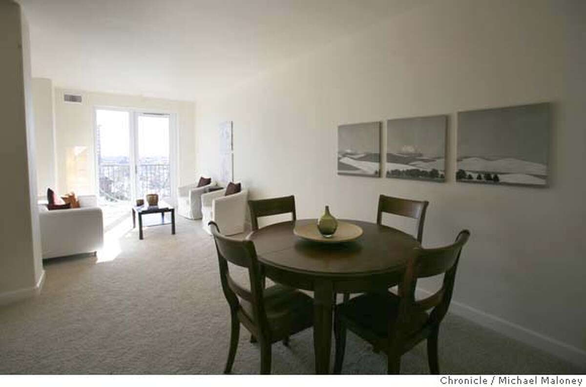 ###Live Caption:Each condo, such as this simple two bedroom unit is designed with Feng Shui principles. This view taken on March 5, 2008 is from the open kitchen, looking past the dining area to the living area. The developer of the recently opened Eight Orchids condominium complex in Oakland, Calif., hopes to sell off nearly a third of the units through a one-day auction on March 30, 2008. Observers say the tactic suggests builders are struggling to unload properties in the current financial climate. Photo by Michael Maloney / San Francisco Chronicle###Caption History:Each condo, such as this simple two bedroom unit is designed with Feng Shui principles. This view taken on March 5, 2008 is from the open kitchen, looking past the dining area to the living area. The developer of the recently opened Eight Orchids condominium complex in Oakland, Calif., hopes to sell off nearly a third of the units through a one-day auction on March 30, 2008. Observers say the tactic suggests builders are struggling to unload properties in the current financial climate. Photo by Michael Maloney / San Francisco Chronicle###Notes:###Special Instructions:MANDATORY CREDIT FOR PHOTOG AND SAN FRANCISCO CHRONICLE/NO SALES-MAGS OUT
