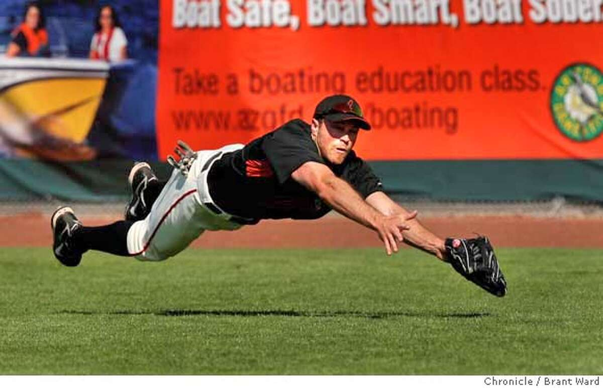 ###Live Caption:A line drive by the Royals Shane Costa is caught by Nate Schierholtz in the 7th inning. On March 5, 2008 the San Francisco Giants lost to the Kansas City Royals in a spring training exhibition game 3-1. Photo by Brant Ward / San Francisco Chronicle###Caption History:A line drive by the Royals Shane Costa is caught by Nate Schierholtz in the 7th inning. On March 5, 2008 the San Francisco Giants lost to the Kansas City Royals in a spring training exhibition game 3-1. Photo by Brant Ward / San Francisco Chronicle###Notes:###Special Instructions:
