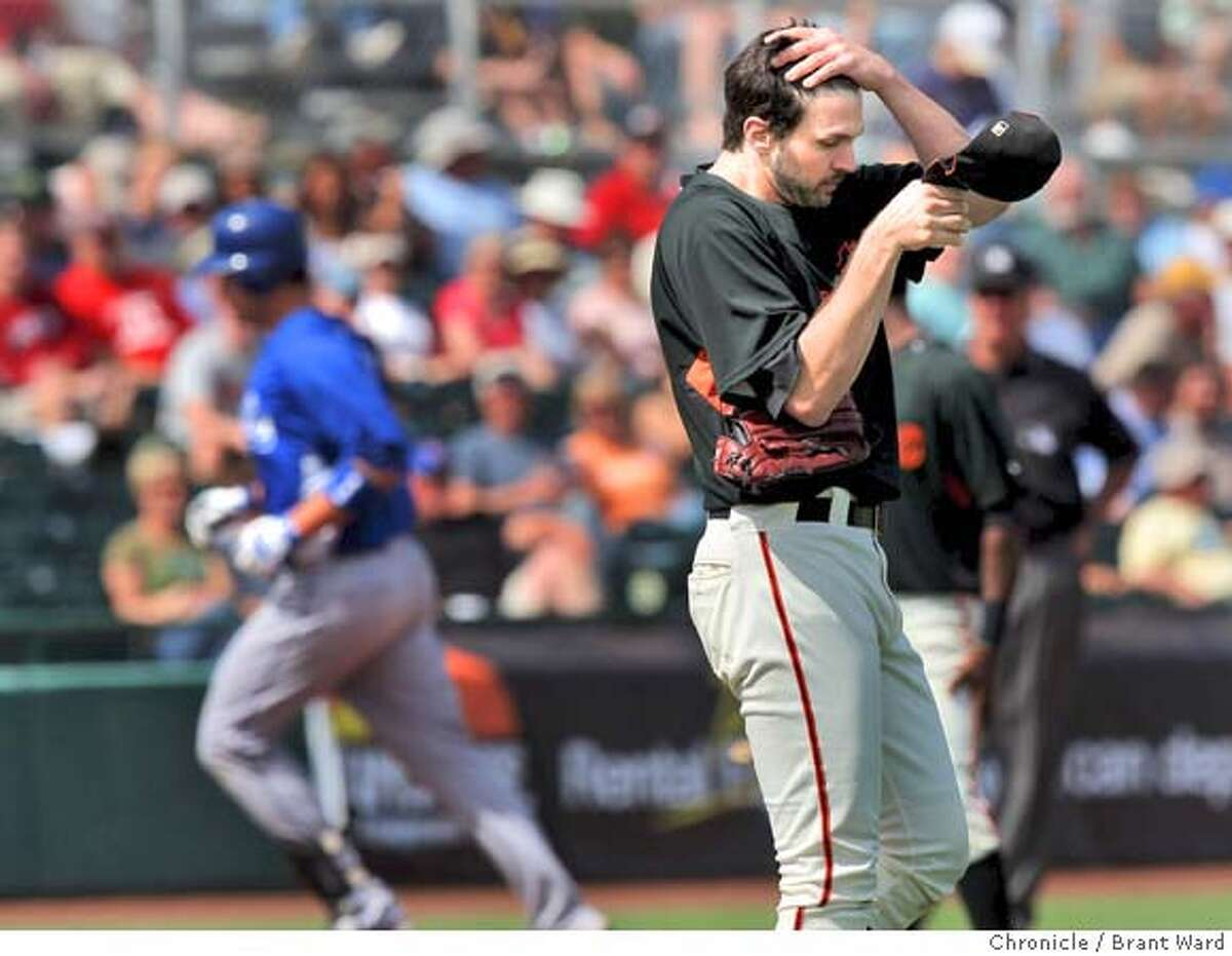 The Giants Barry Zito wiped his brow as Ryan Shealy of the Royals circled the bases. Zito gave up only this run. On March 5, 2008 the San Francisco Giants lost to the Kansas City Royals in a spring training exhibition game 3-1. Photo by Brant Ward / San Francisco Chronicle