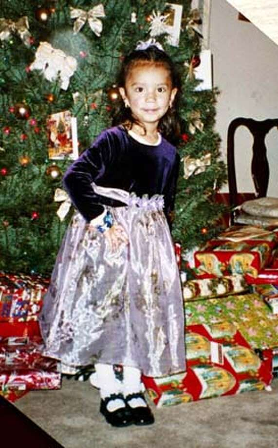 ###Live Caption:Copy photo of Elizabeth Dominguez, Christmas 2002. A memorial was set up at 24th and Portrero for 4 year old Elizabeth Dominguez, killed the day before when a truck spun out of control and pinned her against the side of a restaurant.###Caption History:MEMORIALd-C-12FEB03-MT-MJM  Copy photo of Elizabeth Dominguez, Christmas 2002.  A memorial was set up at 24th and Portrero for 4 year old Elizabeth Dominguez, killed the day before when a truck spun out of control and pinned her against the side of a restaurant. ALSO Ran on: 09-02-2005  Elizabeth Dominguez was walking with her mother on Feb. 11, 2003, when she was hit by a truck.###Notes:###Special Instructions:CAT Photo: MICHAEL MALONEY