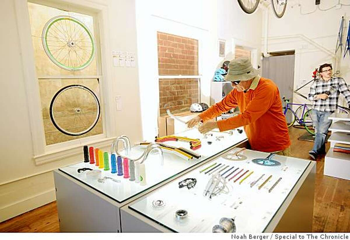 Nick Graven examines bicycle parts at Mission Bicycle Company on Monday, July 6, 2009, in San Francisco.
