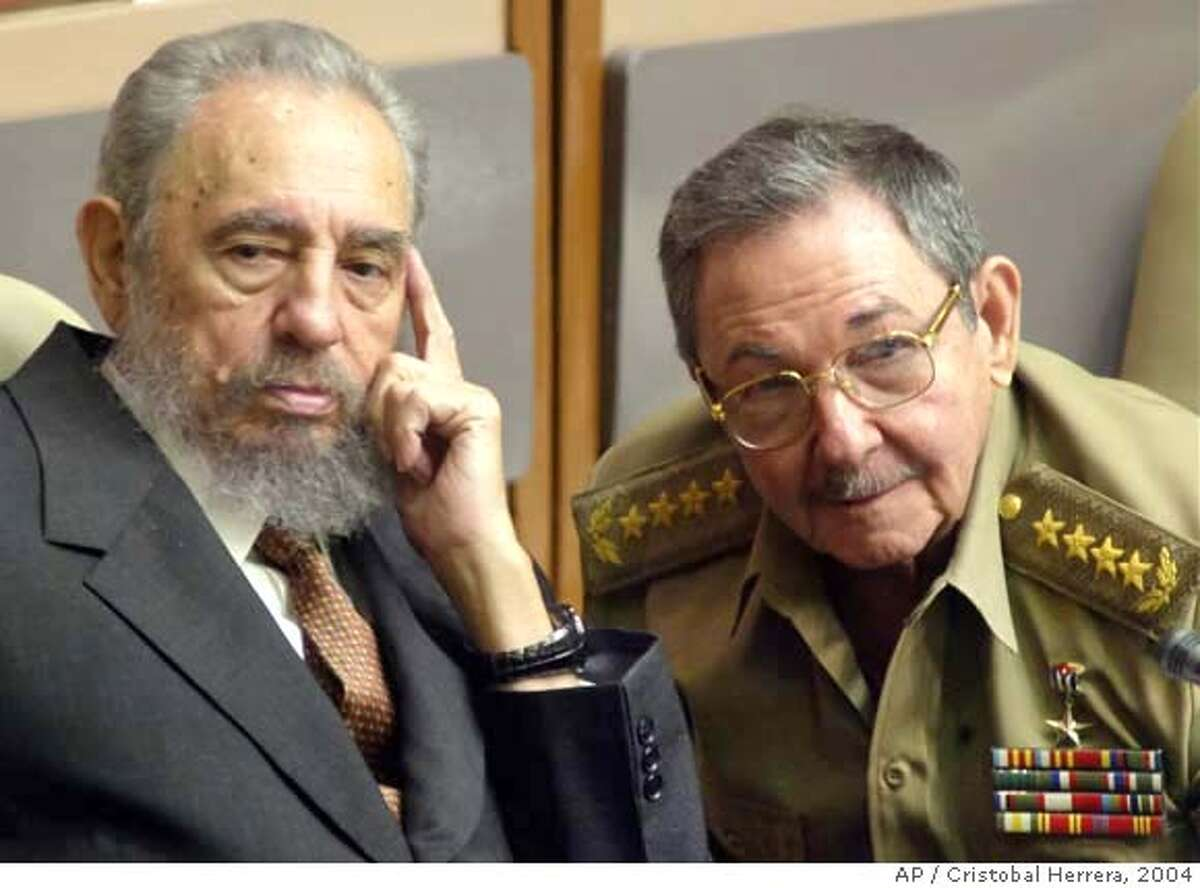 ** FILE ** Cuban President Fidel Castro, left, and his brother, Minister of Defense Raul Castro, attend a Cuban Parliament session in the Palace of Conventions in this July 1, 2004, file photo in Havana, Cuba. Ailing leader Fidel Castro resigned as Cuba's president early Tuesday Feb . 19, 2008, saying in a letter published in official online media that he would not accept a new term when the newly elected parliament meets on Sunday. (AP Photo/Cristobal Herrera, file ) JULY 1, 2004, FILE PHOTO. EFE OUT.