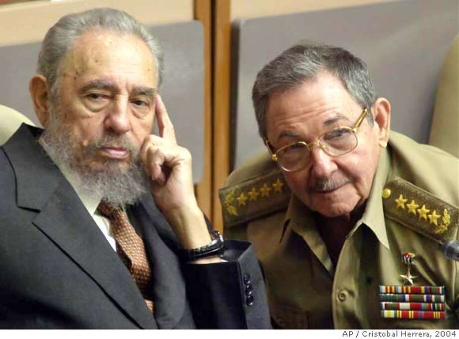 ** FILE ** Cuban President Fidel Castro, left, and his brother, Minister of Defense Raul Castro, attend a Cuban Parliament session in the Palace of Conventions in this July 1, 2004, file photo in Havana, Cuba. Ailing leader Fidel Castro resigned as Cuba's president early Tuesday Feb . 19, 2008, saying in a letter published in official online media that he would not accept a new term when the newly elected parliament meets on Sunday. (AP Photo/Cristobal Herrera, file ) JULY 1, 2004, FILE PHOTO. EFE OUT. Photo: CRISTOBAL HERRERA