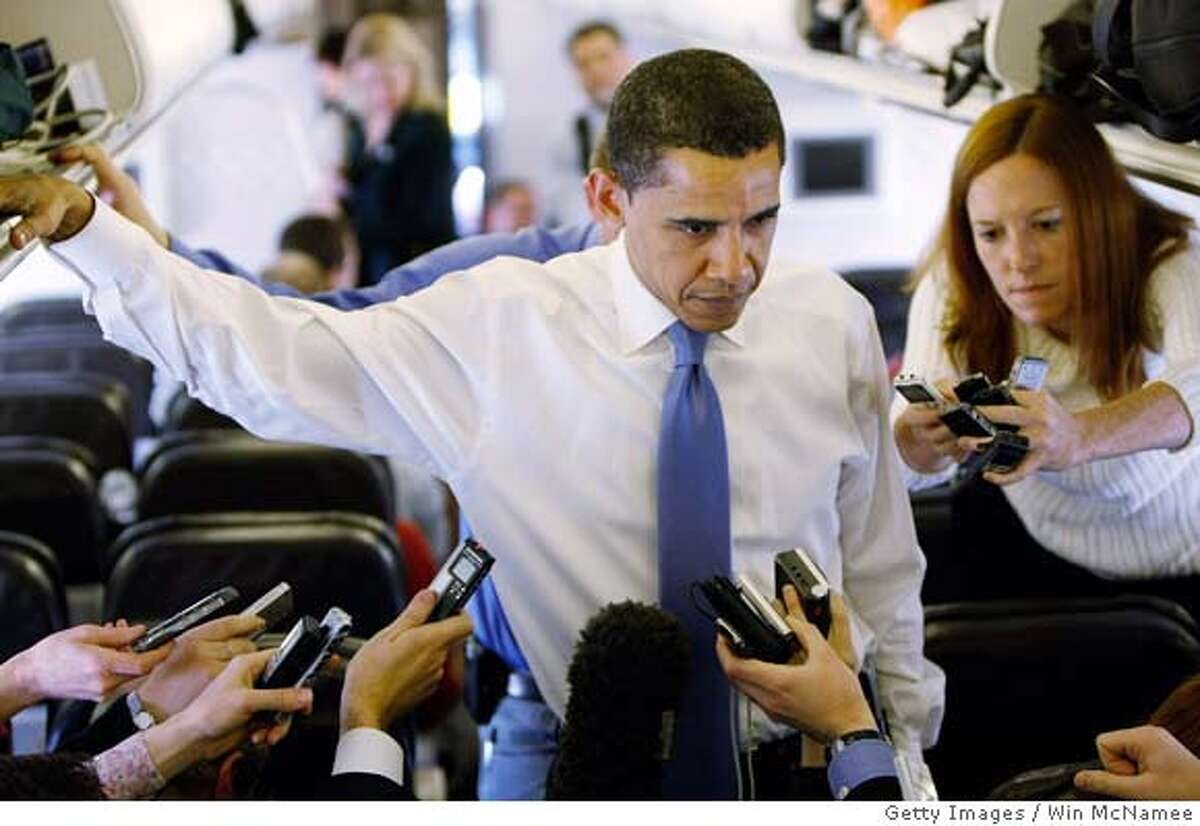 ###Live Caption:SAN ANTONIO - MARCH 05: Democratic presidential candidate Sen. Barack Obama (D-IL) answers questions on his campaign plane March 5, 2008 while departing San Antonio, Texas. Obama won only one of 4 primaries held yesterday as Sen. Hillary Clinton (D-NY) tightened the race by winning in Texas, Ohio and Rhode Island. (Photo by Win McNamee/Getty Images)###Caption History:SAN ANTONIO - MARCH 05: Democratic presidential candidate Sen. Barack Obama (D-IL) answers questions on his campaign plane March 5, 2008 while departing San Antonio, Texas. Obama won only one of 4 primaries held yesterday as Sen. Hillary Clinton (D-NY) tightened the race by winning in Texas, Ohio and Rhode Island. (Photo by Win McNamee/Getty Images)###Notes:Obama Returns To Chicago After Losses In Texas And Ohio###Special Instructions:
