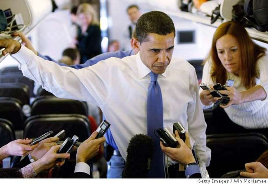 ###Live Caption:SAN ANTONIO - MARCH 05: Democratic presidential candidate Sen. Barack Obama (D-IL) answers questions on his campaign plane March 5, 2008 while departing San Antonio, Texas. Obama won only one of 4 primaries held yesterday as Sen. Hillary Clinton (D-NY) tightened the race by winning in Texas, Ohio and Rhode Island. (Photo by Win McNamee/Getty Images)###Caption History:SAN ANTONIO - MARCH 05: Democratic presidential candidate Sen. Barack Obama (D-IL) answers questions on his campaign plane March 5, 2008 while departing San Antonio, Texas. Obama won only one of 4 primaries held yesterday as Sen. Hillary Clinton (D-NY) tightened the race by winning in Texas, Ohio and Rhode Island. (Photo by Win McNamee/Getty Images)###Notes:Obama Returns To Chicago After Losses In Texas And Ohio###Special Instructions: Photo: Win McNamee