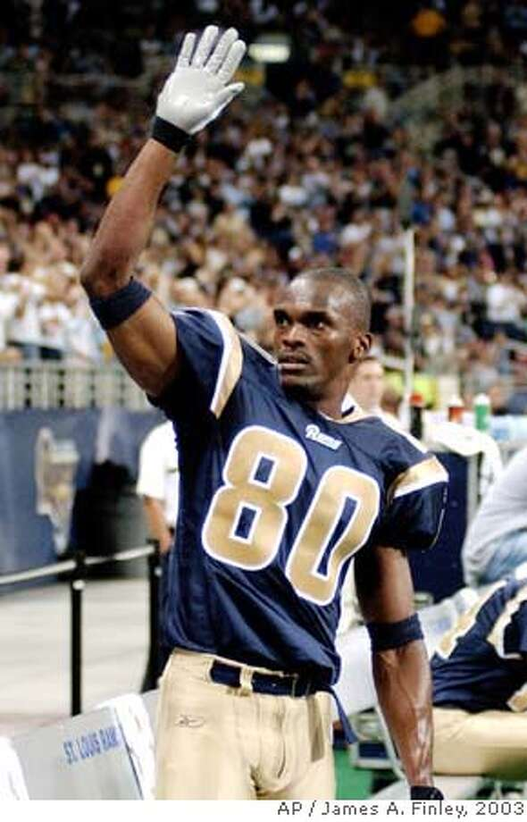 ###Live Caption:St. Louis Rams wide receiver Isaac Bruce waves to fans Sunday, Sept. 28, 2003, during the second half against the Arizona Cardinals after it was announced that he had set a Rams career record for the most receiving yards, passing Henry Ellard, who is now the Rams receivers coach. (AP Photo/James A. Finley)###Caption History:St. Louis Rams wide receiver Isaac Bruce waves to fans Sunday, Sept. 28, 2003, during the second half against the Arizona Cardinals after it was announced that he had set a Rams career record for the most receiving yards, passing Henry Ellard, who is now the Rams receivers coach. (AP Photo/James A. Finley)###Notes:###Special Instructions:CAT Photo: JAMES A. FINLEY