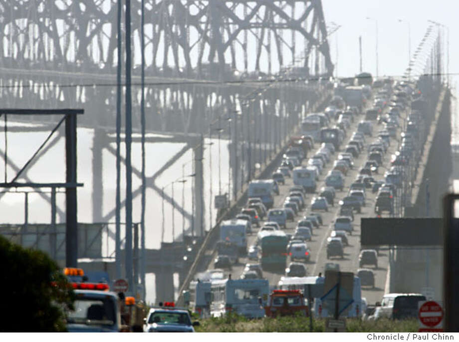 Westbound traffic on the Bay Bridge crawls up the incline section after a jackknifed big rig blocked several lanes of the eastern span in Oakland, Calif., on Tuesday, March 4, 2008. The accident, which took about an hour to clear, backed up the afternoon commute for several miles in the East Bay.  Photo by Paul Chinn / San Francisco Chronicle  Ran on: 03-05-2008  Westbound traffic on the eastern span of the Bay Bridge slows to a creep Tuesday afternoon. An accident at 3:20 p.m. involving a big rig caused the truck to jackknife, and it blocked several lanes of traffic. The mishap took only about an hour to clear, but it was a crucial delay during what is a bad time on a good day. Traffic backed up for several miles in the East Bay.  Ran on: 03-05-2008 Ran on: 03-05-2008  Westbound traffic on the eastern span of the Bay Bridge slows to a creep Tuesday afternoon. An accident at 3:20 p.m. involving a big rig caused the truck to jackknife, and it blocked several lanes of traffic. The mishap took only about an hour to clear, but it was a crucial delay during what is a bad time on a good day. Traffic backed up for several miles in the East Bay.  Ran on: 03-05-2008 Photo: Paul Chinn