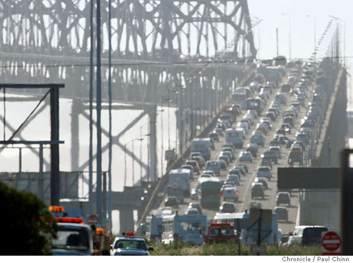 Westbound traffic on the Bay Bridge crawls up the incline section after a jackknifed big rig blocked several lanes of the eastern span in Oakland, Calif., on Tuesday, March 4, 2008. The accident, which took about an hour to clear, backed up the afternoon commute for several miles in the East Bay. Photo by Paul Chinn / San Francisco Chronicle Ran on: 03-05-2008 Westbound traffic on the eastern span of the Bay Bridge slows to a creep Tuesday afternoon. An accident at 3:20 p.m. involving a big rig caused the truck to jackknife, and it blocked several lanes of traffic. The mishap took only about an hour to clear, but it was a crucial delay during what is a bad time on a good day. Traffic backed up for several miles in the East Bay. Ran on: 03-05-2008 Ran on: 03-05-2008 Westbound traffic on the eastern span of the Bay Bridge slows to a creep Tuesday afternoon. An accident at 3:20 p.m. involving a big rig caused the truck to jackknife, and it blocked several lanes of traffic. The mishap took only about an hour to clear, but it was a crucial delay during what is a bad time on a good day. Traffic backed up for several miles in the East Bay. Ran on: 03-05-2008