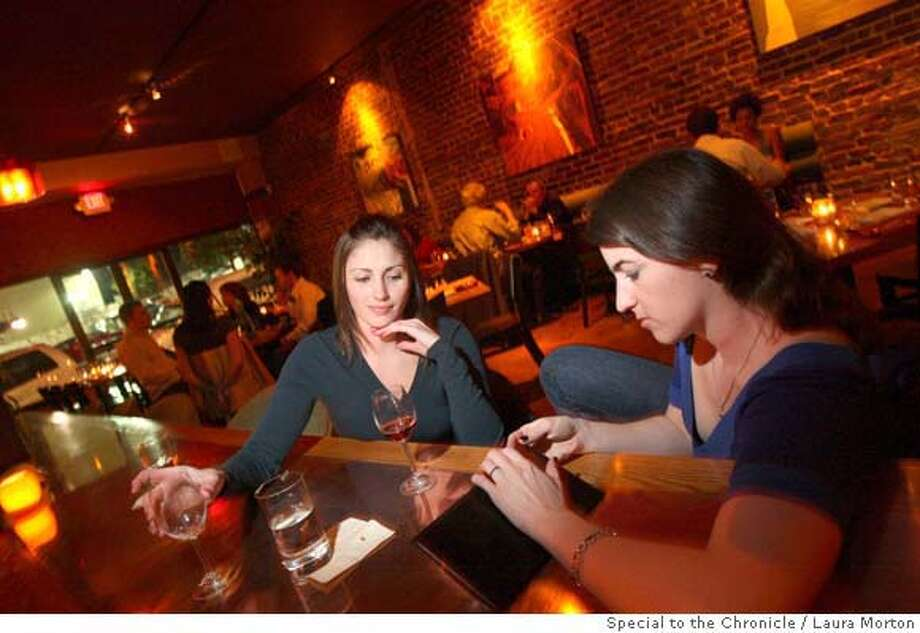 Laura Mitchell and Sarah Offenbach (right) enjoy a few drinks at Brick, a cozy restaurant and bar in San Francisco. (Laura Morton/Special to the Chronicle) Photo: Laura Morton