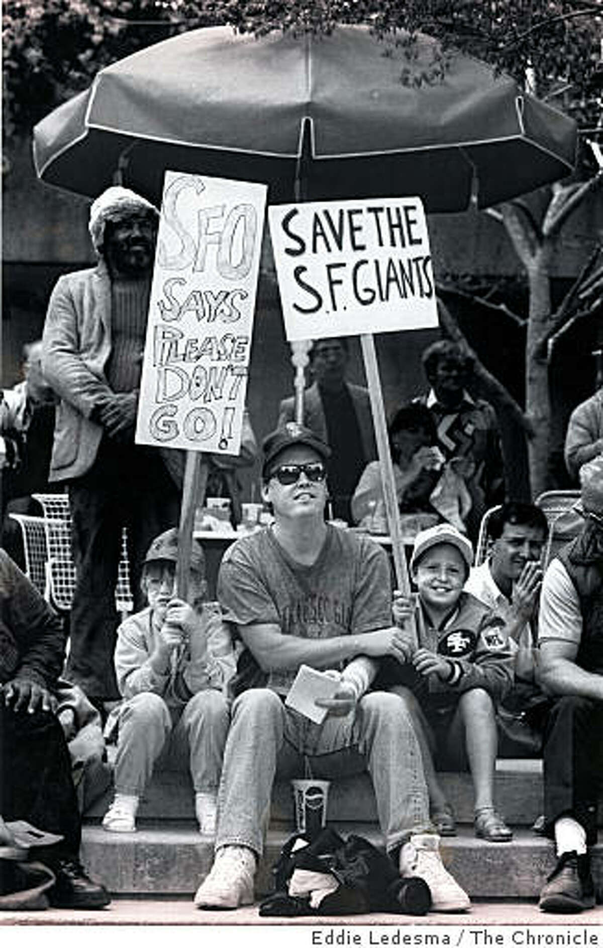 (From left) Katie Fischer, 7, Joe Fischer, 35, and Kelly Fischer, 9, attend a Save the Giants rally to keep them in San Francisco. Aug. 28, 1992. The last time a professional sports team packed its bags to leave San Francisco, the city responded with tenacious force. There were public rallies, private meetings and everything in-between, with the mayor in the thick of the fray. But that was 1992. The team was the Giants, not the 49ers.