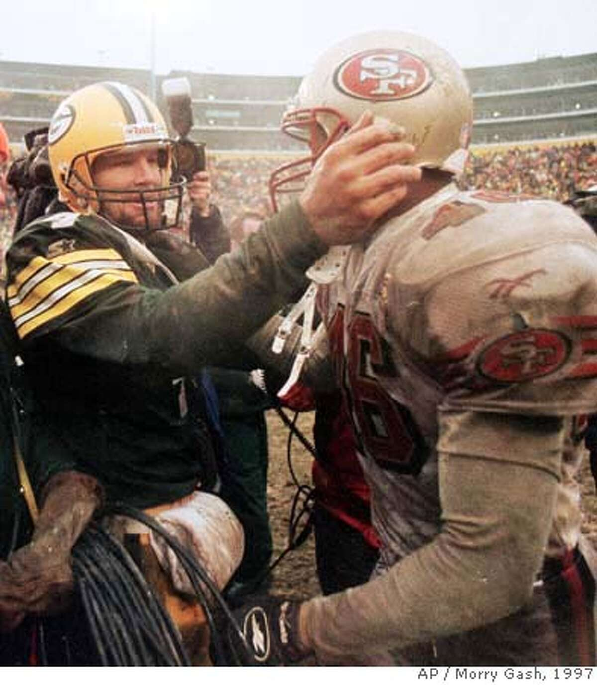 ###Live Caption:** FILE ** Green Bay Packers quarterback Brett Favre, left, talks with San Francisco 49ers safety Tim McDonald after Green Bay won 35-14 to advance to the NFC Conference finals in Green Bay, Wis., in this Jan. 4, 1997 file photo. Brett Favre has decided to retire from the NFL after 17 seasons. FOX Sports first reported Tuesday March 4, 2008 that the Green Bay Packers quarterback informed the team in the last few days.(AP Photo/Morry Gash)###Caption History:** FILE ** Green Bay Packers quarterback Brett Favre, left, talks with San Francisco 49ers safety Tim McDonald after Green Bay won 35-14 to advance to the NFC Conference finals in Green Bay, Wis., in this Jan. 4, 1997 file photo. Brett Favre has decided to retire from the NFL after 17 seasons. FOX Sports first reported Tuesday March 4, 2008 that the Green Bay Packers quarterback informed the team in the last few days.(AP Photo/Morry Gash)###Notes:Brett Favre###Special Instructions:JAN. 4, 1997 FILE PHOTO EFE OUT
