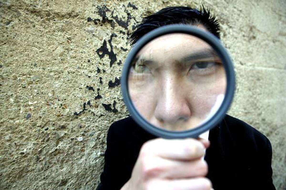 Hann Weinn Chin participating in Jayson Wechter1s Chinese New Year Treasure Hunt. Ran on: 02-18-2005 Photo caption