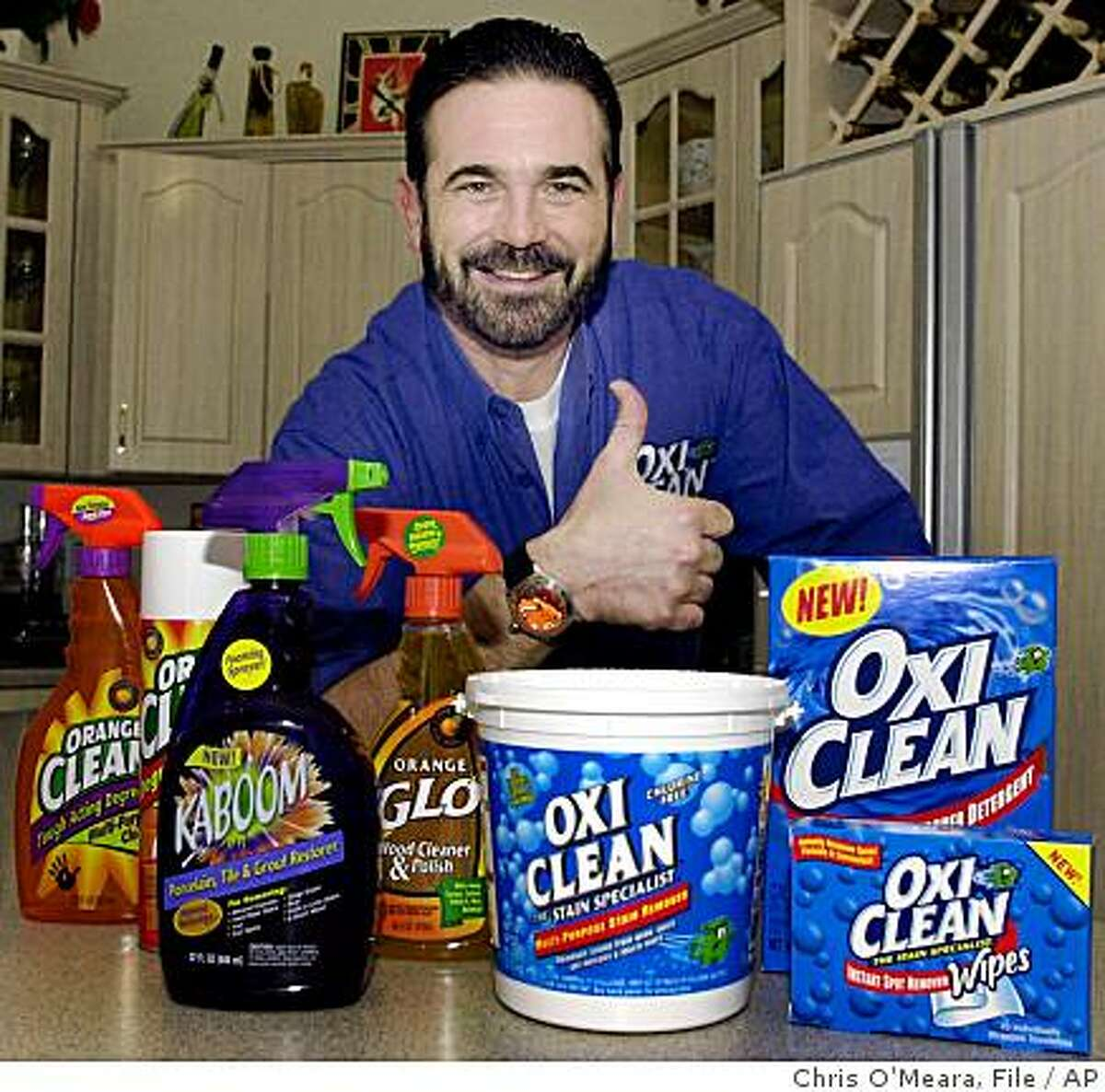 FILE - In this Dec. 6, 2002 file photo,TV pitchman Billy Mays poses with some of his cleaning products at his Palm Harbor, Fla., home. Tampa police say Mays, the television pitchman known for his boisterous hawking of products such as Orange Glo and OxiClean, has died. He was 50. (AP Photo/Chris O'Meara, File)