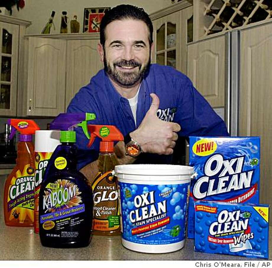 FILE - In this Dec. 6, 2002  file photo,TV pitchman Billy Mays poses with some of his cleaning products at his Palm Harbor, Fla., home. Tampa police say Mays, the television pitchman known for his boisterous hawking of products such as Orange Glo and OxiClean, has died. He was 50. (AP Photo/Chris O'Meara, File) Photo: Chris O'Meara, File, AP