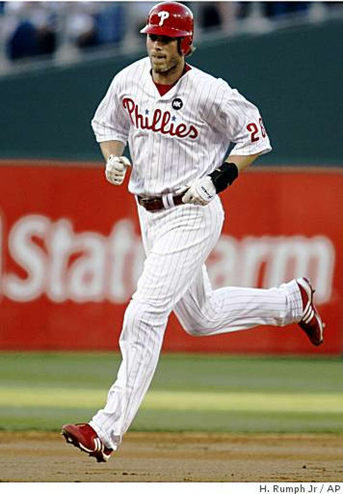 Philadelphia Phillies' Jayson Werth runs the bases after hitting a solo home run against the Cincinnati Reds in the second inning of a baseball game Tuesday, July 7, 2009, in Philadelphia. (AP Photo/H. Rumph Jr.)