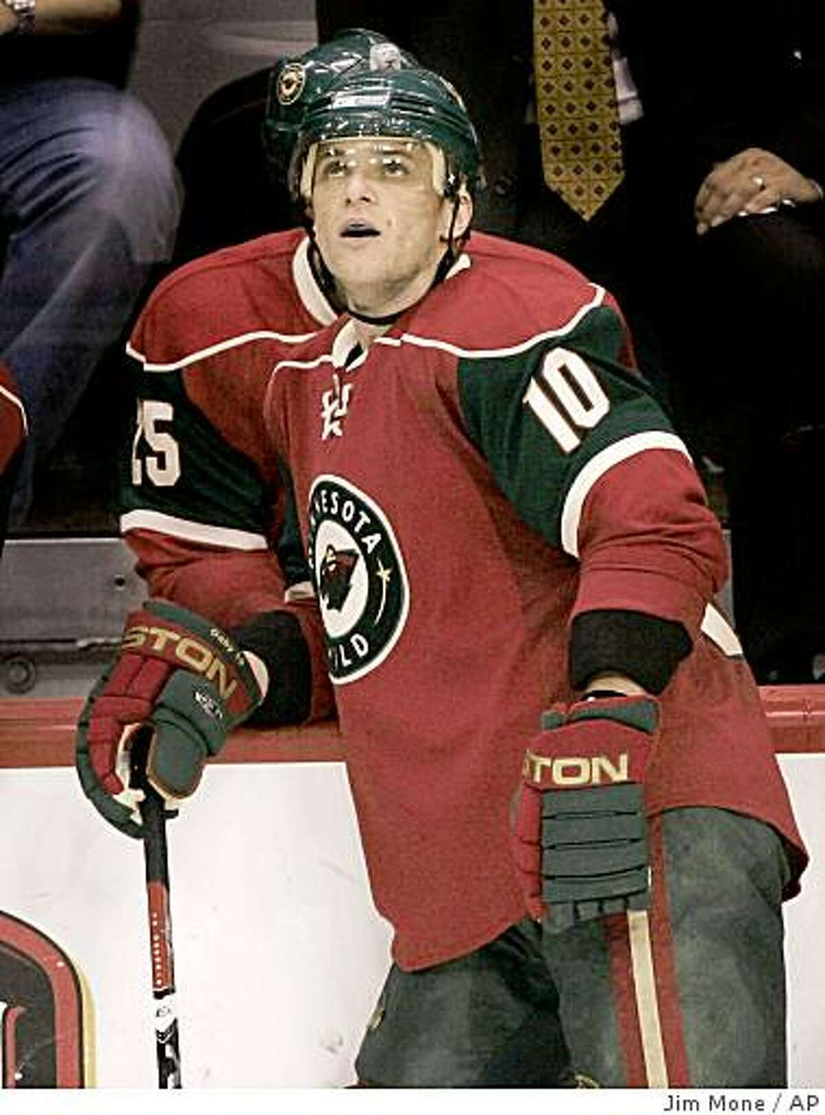 **ADVANCE FOR RELEASE WEEKEND EDITIONS JAN. 19-21** Minnesota Wild's Marian Gaborik, of Slovakia, takes a break during an NHL hockey game against the Vancouver Canucks on Nov. 21, 2007 in St. Paul, Minn. Chosen as an All-Star for the second time, Gaborik has skated in all but five of Minnesota's games and has climbed to seventh in the league in goals. (AP Photo/Jim Mone)