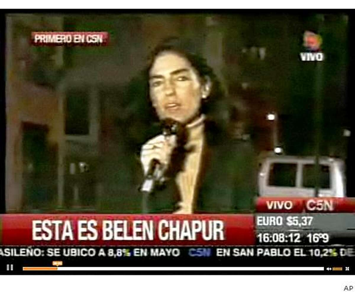 In this undated video frame grabbed taken from a C5N TV Channel from Argentina report sometime during the Sept.11, 2001 twin towers attacks in New York, Argentine Maria Belen Chapur speaks during a stand up. The 41-year-old Argentine woman, who had worked as free-lance journalist in the past, has acknowledged having a relationship with South Carolina Gov. Mark Sanford. In a statement sent to news network C5N of Buenos Aires, Chapur says she will not talk about her private life, but also said the email exchanges with Sanford that were widely published by U.S. media and elsewhere were obtained by someone who hacked her account.(AP Photo/C5N TV)