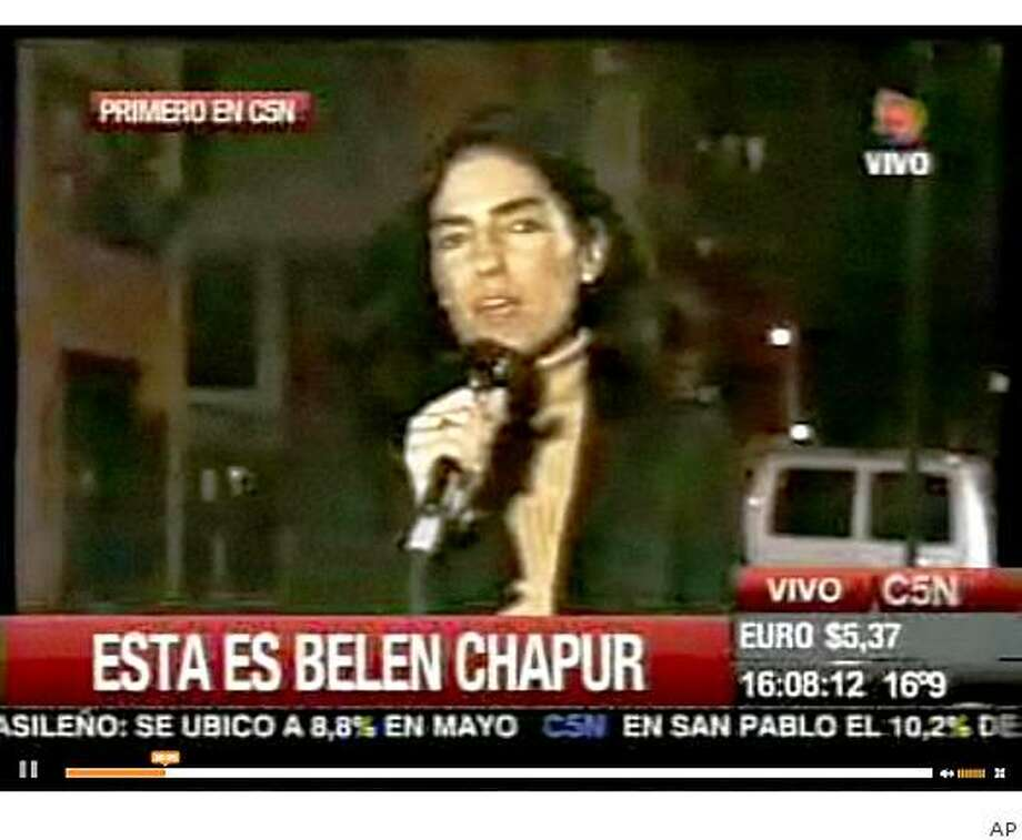 In this undated video frame grabbed taken from a C5N TV Channel from Argentina report sometime during the Sept.11, 2001 twin towers attacks in New York, Argentine Maria Belen Chapur speaks during a stand up. The 41-year-old Argentine woman, who had worked as free-lance journalist in the past, has acknowledged having a relationship with South Carolina Gov. Mark Sanford. In a statement sent to news network C5N of Buenos Aires,  Chapur says she will not talk about her private life, but also said the email exchanges with Sanford that were widely published by U.S. media and elsewhere were obtained by someone who hacked her account.(AP Photo/C5N TV) Photo: AP