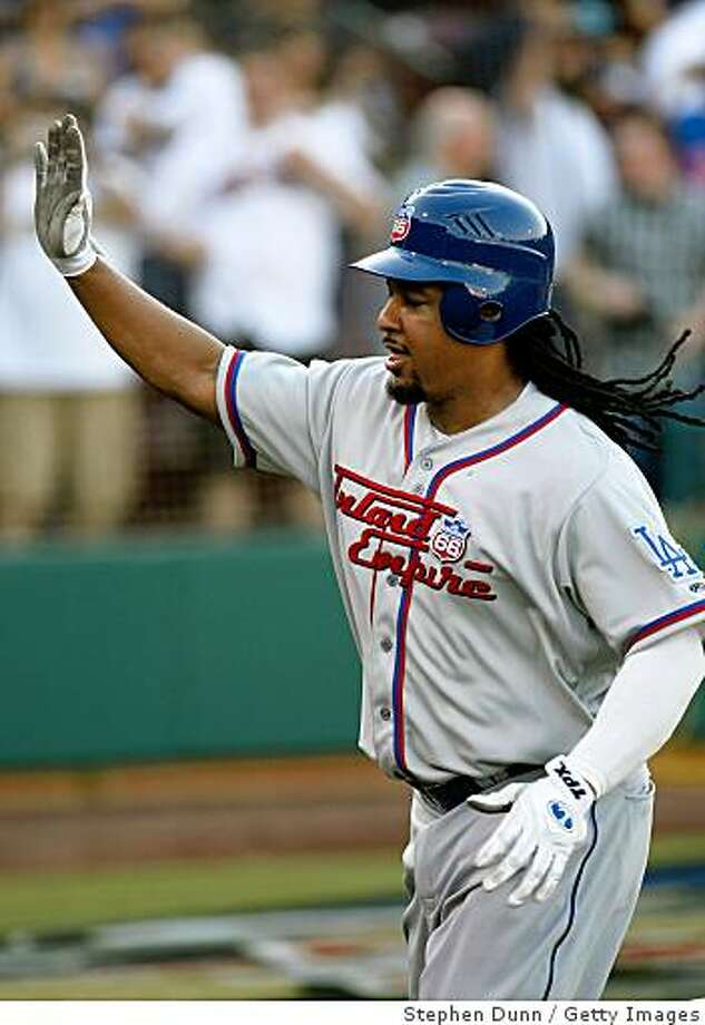 LAKE ELSINORE, CA - JUNE 27:  Manny Ramirez #99 of the Inland Empire 66ers celebrates as he scores on his lead off home run in the first inning against the Lake Elsinore Storm on June 27, 2009 at the Lake Elsinore Diamond in Lake Elsinore, California. Ramirez is preparing for hsi return to the Los Angeles Dodgers after a 50 game suspension.  (Photo by Stephen Dunn/Getty Images) Photo: Stephen Dunn, Getty Images