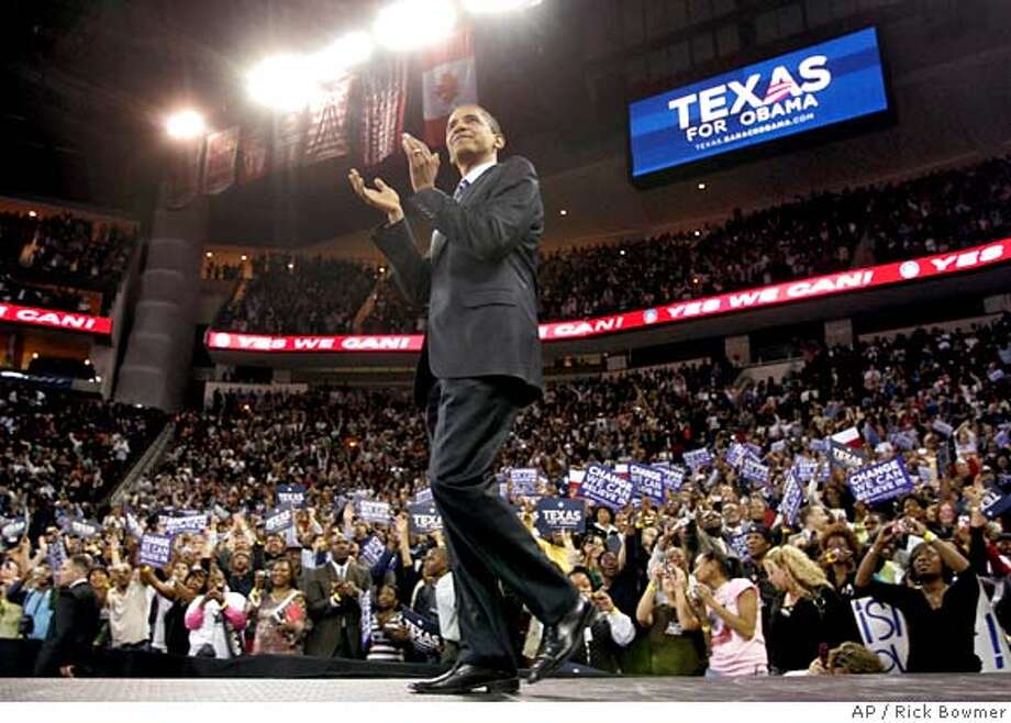 Democratic presidential hopeful Sen. Barack Obama, D-Ill., walks on stage during a rally Tuesday, Feb. 19, 2008, in Houston. (AP Photo/Rick Bowmer) Photo: Rick Bowmer