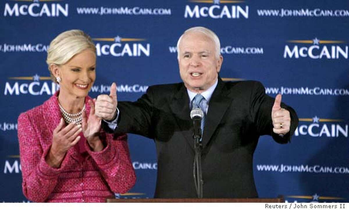 Republican presidential candidate Senator John McCain (R-AZ) gestures during his remarks as his wife Cindy applauds at his Wisconsin primary election night rally in Columbus, Ohio February 19, 2008. REUTERS/ John Sommers II (UNITED STATES) US PRESIDENTIAL ELECTION CAMPAIGN 2008 (USA) Ran on: 02-20-2008 Barack Obama acknowledges supporters at a rally in Houston after winning the Wisconsin primary.