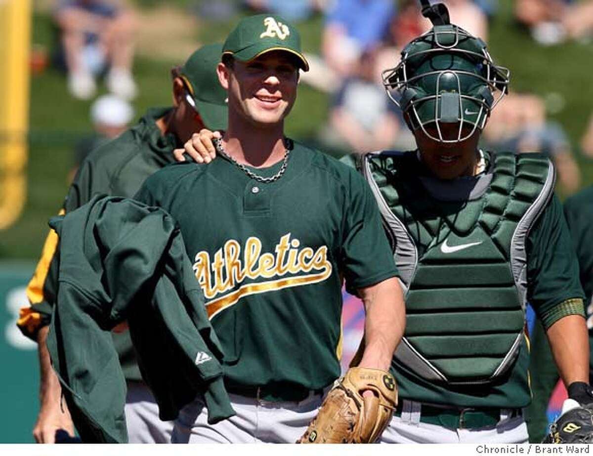 A's starting pitcher Rich Harden was escorted from the bullpen by catcher Kurt Suzuki before the start of his first game in 2008. On March 4, 2008 the Oakland Athletics played the Los Angeles Angels at Tempe Diablo Stadium in a spring training game. Photo by Brant Ward / San Francisco Chronicle