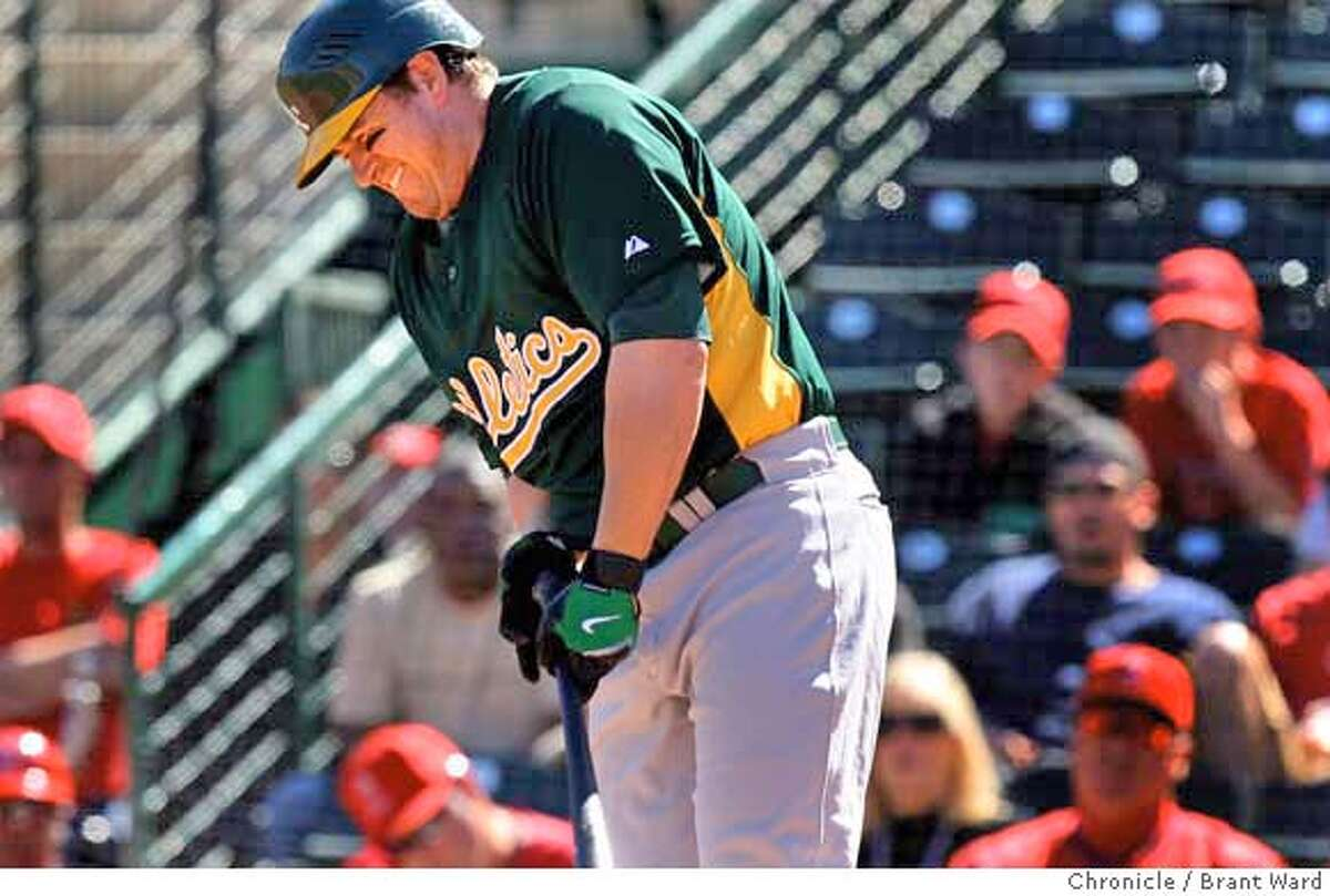 The A's Jack Cust grimaces after being hit by a pitch by Joe Saunders in the third inning. On March 4, 2008 the Oakland Athletics played the Los Angeles Angels at Tempe Diablo Stadium in a spring training game. Photo by Brant Ward / San Francisco Chronicle