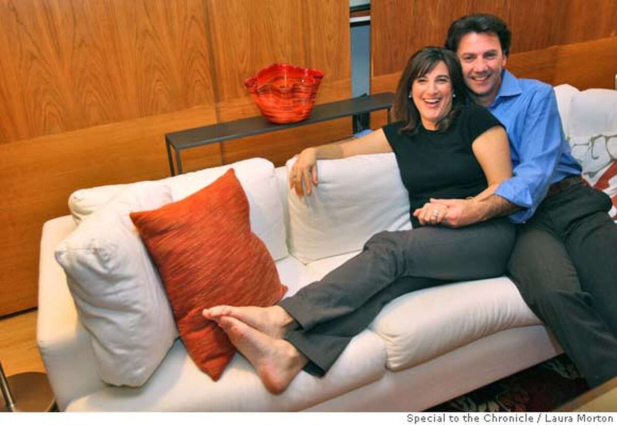 Marcy and Franco Moriconi on the couch in their Berkley, CA home. (Laura Morton/Special to the Chronicle)